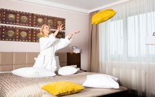 Free Young Woman Playing With Pillows In Bed Royalty Free Stock Image - 13788636
