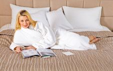 Free Woman Lying On Bed Reading Magazine Royalty Free Stock Images - 13788849