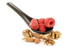 Frozen Raspberries On A Spoon With Nuts Royalty Free Stock Images