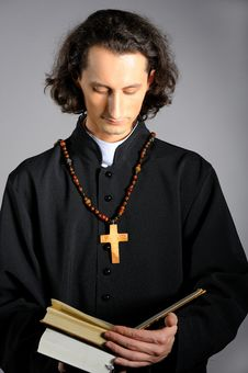 Praying Priest With Wooden Cross And Bible Stock Image