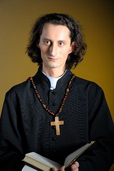 Praying Priest With Wooden Cross And Bible Stock Photography
