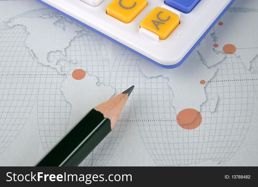 World map, pencil and calculator