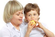 Free Woman And Boy Eating Apple Royalty Free Stock Image - 13791506