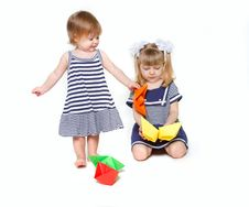 Free Two Sisters In Sailor Dresses With Paper Ships Royalty Free Stock Photo - 13792175