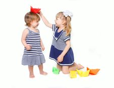 Two Sisters In Sailor Dresses With Paper Ships Stock Photo
