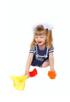 Free Cute Girl In Sailor Dress With Paper Ships Royalty Free Stock Photography - 13792207