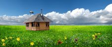 Free Little House On Meadow And Stork Stock Photography - 13794072