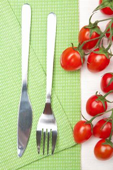 Fork Knife And Tomatoes Stock Image