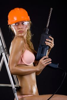 Free Girl In A Helmet With A Drill Stock Photos - 13794483