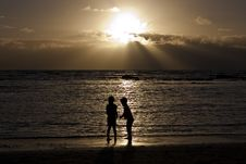 Two Children On The Beach At Sunset Stock Photos