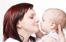Free Cute Baby Trying To Kiss Her Mother Royalty Free Stock Image - 13796976