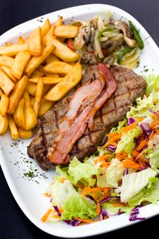Free Sirloin Steak With Chips And Bacon Stock Images - 13797254