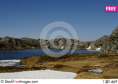 Mountain lake and permafrost Stock Photo