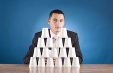 Free Businessman Building Cups  Pyramid Stock Images - 1383244