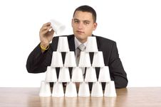 Free Businessman Building Cups  Pyramid Royalty Free Stock Photo - 1383255