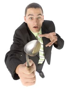 Free Businessman Bending Spoon By Mind Force Royalty Free Stock Photography - 1383477
