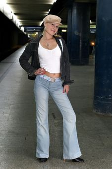 Girl At A Train Station Stock Photo