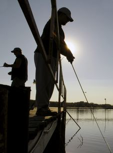 Free Fishermen Silhouette Royalty Free Stock Image - 1386626