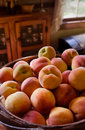 Free A Basket Full Of Peaches Sitting On Counter Stock Image - 13806861