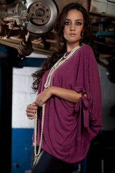 Free Fashion Shot In Auto Repair Shop. Royalty Free Stock Images - 13800069