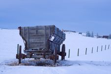 Free Old Antique Wagon In Snow Covered Field Stock Images - 13801094