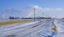 Country Road With Electric Poles Stock Photo