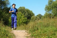 Free Man Wearing Sporty Clothes Is Running Along Path Stock Photography - 13802942