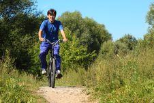 Free Man Wearing Sporty Clothes Is Riding On Bycicle Royalty Free Stock Photos - 13802978
