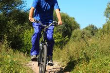 Man Wearing Sporty Clothes Is Riding On A Bycicle Stock Photos