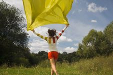 Woman In Sunny Day Runnig With Yellow Fabric Royalty Free Stock Images