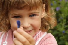 Free Girl Holding In Her Hand Annual Delphinium Stock Image - 13803571