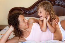 Free Mother And Daugther Lying And Embracing On Bed Stock Photos - 13803673