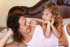 Mother And Daugther Embracing On Bed Royalty Free Stock Image