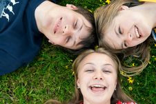 Free Three Friends Lay On A Grass Stock Images - 13803784