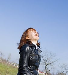 Free Girl Laughing On The Blue Sky Background Stock Photography - 13805042
