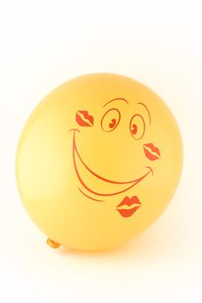 Free Smiling Yellow Balloon In The Imprints Kisses Stock Photography - 13805562