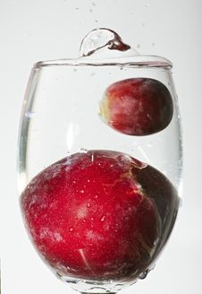 Splash Of Water With Grape Fruit And Cherry Stock Photos