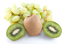 Cluster Of Grapes And Kiwi Fruit Stock Photo