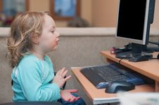 Free Little Baby Girl Using A Desktop Computer Royalty Free Stock Photo - 13809715