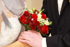 Free Bride And Groom With Red Rose Bouquet. Royalty Free Stock Image - 13810676