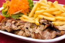 Free Pork Chop With French Fries And Salad Of Carrot An Stock Images - 13811534