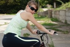 Free Woman Cycling In A Park Royalty Free Stock Image - 13814226