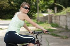 Free Woman Cycling In A Park Stock Photography - 13814232