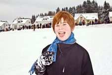 Boy With Red Hair Enjoying   The Snow Stock Photo
