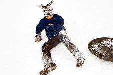Child Sledding Down The Hill In Snow, White Winter Stock Photos