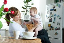 Mother Feeding Baby Stock Image