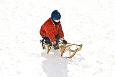 Free Young Boy Sledding Down The Hill Royalty Free Stock Photo - 13815245