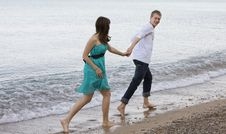 Couple Enjoying Themselves On The Beach Stock Photography
