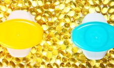 Yellow Pills (capsules) And Two Colorful Cans Royalty Free Stock Image