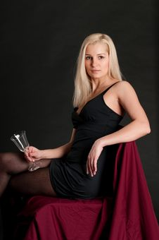 Free Blonde Girl With A Wineglass Stock Photo - 13818020